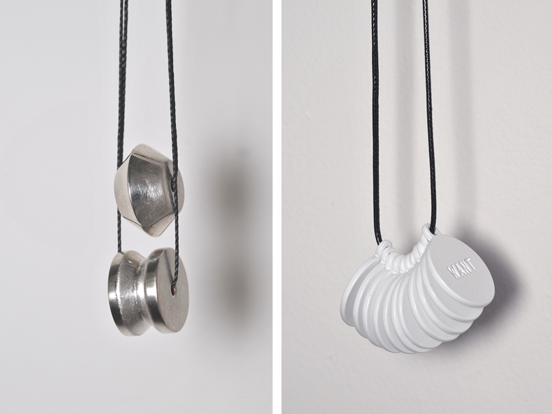 (left) Nellie Peoples, Line in the Sand, 2016, pendant, sterling silver, silk cord, 16 x 10 mm; (right) Zoe Brand, Want, Want, W