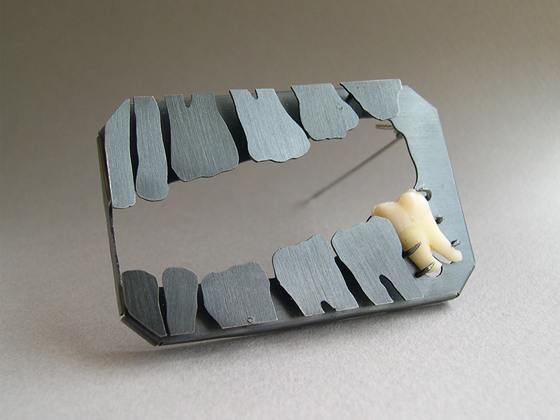 Peter Machata, Absence Of, from the Rekonstructions series, 2004, brooch, silver, tooth, photo courtesy of the artist